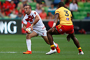 Josh Hodgson of England goes to pass the ball in front of Kato Ottio of Papua New Guinea  during the Rugby League World Cup Quarter-Final match between England and  Papua New Guinea at Melbourne Rectangular Stadium, Melbourne, Australia on 19 November 2017. Photo by Mark  Witte.