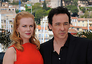 """Cannes,24.05.2012: NICOLE KIDMAN FASHION FAUX-PAS.During """"The Paperboy"""" photocall at the 65th Cannes International Film Festival, Kidman committed a fashion faux by exposing her bra strap..Kidman is prictured with John Cusack..Mandatory Credit Photos: ©NEWSPIX INTERNATIONAL..**ALL FEES PAYABLE TO: """"NEWSPIX INTERNATIONAL""""**..PHOTO CREDIT MANDATORY!!: NEWSPIX INTERNATIONAL(Failure to credit will incur a surcharge of 100% of reproduction fees)..IMMEDIATE CONFIRMATION OF USAGE REQUIRED:.Newspix International, 31 Chinnery Hill, Bishop's Stortford, ENGLAND CM23 3PS.Tel:+441279 324672  ; Fax: +441279656877.Mobile:  0777568 1153.e-mail: info@newspixinternational.co.uk"""