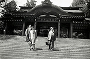 temple gate with men walking down the stairs Japan 1960s