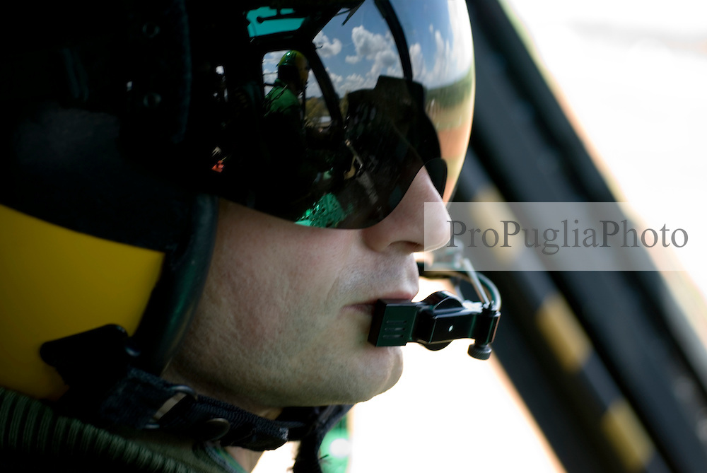 Puglia, pilots of the italian Coast Guard fly over souther Italy on board of their helicopter.