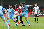 Mohamed Eisa and Jordon Willis during the EFL Sky Bet League 2 match between Cheltenham Town and Coventry City at LCI Rail Stadium, Cheltenham, England on 28 April 2018. Picture by Antony Thompson.