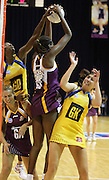 Romelda Aiken takes the ball over the Pulse defenders. ANZ Netball Championship. Round 3 - Queensland Firebirds v Central Pulse. Played at Brisbane Convention Centre. Firebirds (56) defeated the Pulse (28).  Photo: Warren Keir (SMP/Photosport NZ).<br /> <br /> Use information: This image is intended for Editorial use only (e.g. news or commentary, print or electronic). Any commercial or promotional use requires additional clearance.
