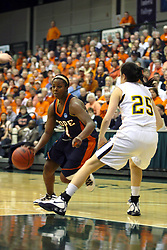 19 March 2010: Philana Green takes the lane guarded by Caroline Bernal-Silva. The Flying Dutch of Hope College defeat the Yellowjackets of the University of Rochester in the semi-final round of the Division 3 Women's Basketball Championship by a score of 86-75 at the Shirk Center at Illinois Wesleyan in Bloomington Illinois.