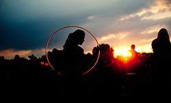 Concert-goer enjoy the waining summer sun and dance in celebration with a hula hoop during a Galactic concert at Hartwood Acres Park in the North Hills of Pittsburgh.