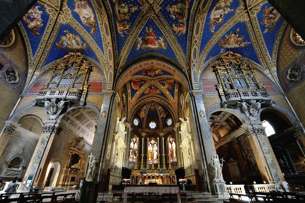 The gothic nave and deep blue ceiling of Santa Maria sopra Minerva basilica, a Christian church in the old city center, Rome, Italy.