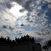 "Fans in the ""FanZone"" area watch as drivers prepare to take the track during the 56th Annual NASCAR Daytona 500 practice session at Daytona International Speedway on Saturday, February 22, 2014 in Daytona Beach, Florida.  (AP Photo/Alex Menendez)"