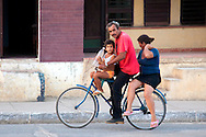Family on a bicycle in Niquero,  Granma, Cuba.