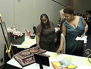 Sheri Wise (left) and Nan-C Moss, both from Dayton look at silent auction items at the 21st birthday party of the Human Race Theatre Company in Sinclair's Ponitz Center, Saturday night, April 28th.