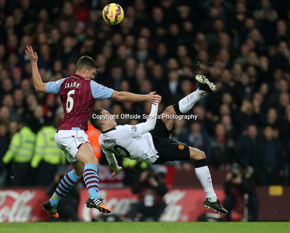 20th December 2014 - Barclays Premier League - Aston Villa v Manchester United - Robin Van Persie of Manchester United tries an overhead kick with Ciaran Clarke of Aston Villa in close attendance - Photo: Paul Roberts / Offside.