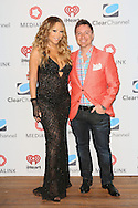 CAP D'ANTIBES, FRANCE - JUNE 17:  Mariah Carey and Darren Davis, President of Networks, Clear Channel attend Clear Channel Media And Entertainment And MediaLink Dinner at Hotel du Cap-Eden-Roc on June 17, 2014 in Cap d'Antibes, France.  (Photo by Tony Barson/Getty Images for Clear Channel)