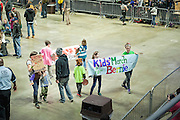A young couple escorts a group of youngsters as they diplay banners to the Bernie supporters in the Liacouras Arena in Philadelphia during his rally.