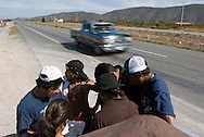 NEWS&GUIDE PHOTO / PRICE CHAMBERS.The group gathers around the map once more as they wind through the Mexican countryside south of Monterey.