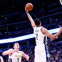 01 April 2018: Denver Nuggets forward Trey Lyles (7) grabs a rebound during the Denver Nuggets 128-125 victory over the Milwaukee Bucks, at the Pepsi Center, Denver, Colorado, USA.