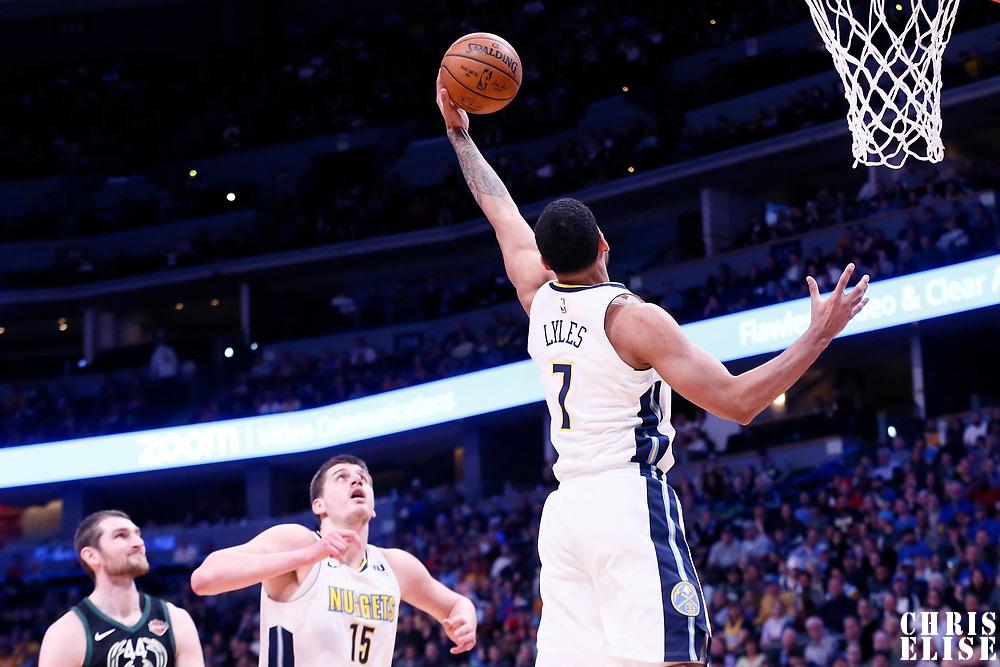 01 April 2018: Denver Nuggets forward Trey Lyles (7) grabs a rebound during the Denver Nuggets 128-125 victory over the Milwaukee Bucks, at the Pepsi Center, Denver, Colorado, USA.