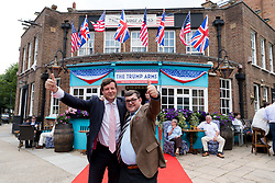 © Licensed to London News Pictures. 13/07/2018. London, UK.  Guests arrive at the Donald Trump special relationship evening and welcome party held at  the Trump Arms Pub (formerly known as Jameson Pub) in Hammersmith, west London. The pub has been decked out with American flags and banners celebrating Donald Trump's arrival in the UK..  Photo credit: Vickie Flores/LNP