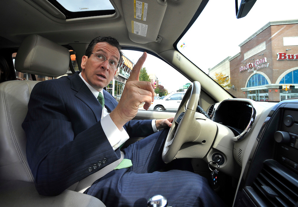 Democratic candidate for governor and former Stamford Mayor Dan Malloy points out a new hotel that was build while he was mayor during a tour of the city of Stamford, Conn. (AP Photo/Jessica Hill)