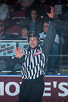 KELOWNA, CANADA - MARCH 31: Linesman Dustin Minty makes a call at the Kelowna Rockets against the Kamloops Blazers on March 31, 2017 at Prospera Place in Kelowna, British Columbia, Canada.  (Photo by Marissa Baecker/Shoot the Breeze)  *** Local Caption ***