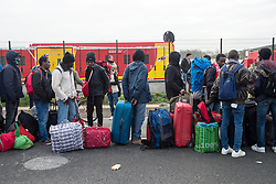 October 24, 2016 - Calais, Northern France, France - Image ¬©Licensed to i-Images Picture Agency. 24/10/2016. Calais, France. Calais Jungle Eviction. Migrants and refugees line up to be processed and then bussed out out to reception centres across France. It is estimated that 3000 refugees and migrants to be processed. Picture by Pete Maclaine / i-Images (Credit Image: © Pete Maclaine/i-Images via ZUMA Wire)