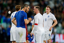 Leonardo Bonucci of Italy and Wayne Rooney of England swap shirts at full time after the match ends with a 1-1 draw - Photo mandatory by-line: Rogan Thomson/JMP - 07966 386802 - 31/03/2015 - SPORT - FOOTBALL - Turin, Italy - Juventus Stadium - Italy v England - FIFA International Friendly Match.