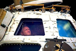 "Scott Kelly releases a photo on Twitter with the following caption: """"Happy Birthday, @Space_Station! Bittersweet final moment in the cupola before returning to Earth after my #yearinspace. Having spent 500 days of my life on ISS, I'm inspired if we can do this—the hardest thing we've ever done—we can do anything if we choose to & we work together."""". Photo Credit: Twitter *** No USA Distribution *** For Editorial Use Only *** Not to be Published in Books or Photo Books ***  Please note: Fees charged by the agency are for the agency's services only, and do not, nor are they intended to, convey to the user any ownership of Copyright or License in the material. The agency does not claim any ownership including but not limited to Copyright or License in the attached material. By publishing this material you expressly agree to indemnify and to hold the agency and its directors, shareholders and employees harmless from any loss, claims, damages, demands, expenses (including legal fees), or any causes of action or allegation against the agency arising out of or connected in any way with publication of the material."