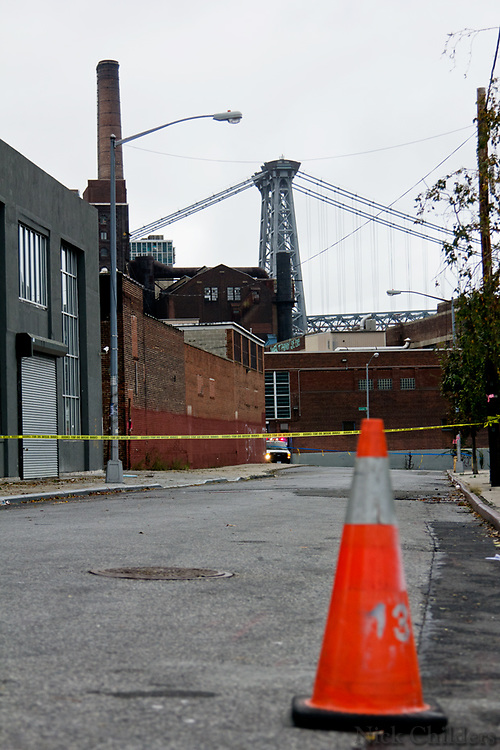 Police guard the entrance to an electrical substation the day after Hurricane Sandy in Williamsburg, Brooklyn- New York City