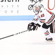 Colton Saucerman #23 of the Northeastern Huskies with the puck during the game at Matthews Arena on February 22, 2014 in Boston, Massachusetts. (Photo by Elan Kawesch)