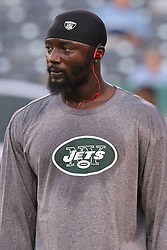 Aug 26, 2012; East Rutherford, NJ, USA; New York Jets wide receiver Santonio Holmes (10) during warmups for their game against the Carolina Panthers at MetLife Stadium.