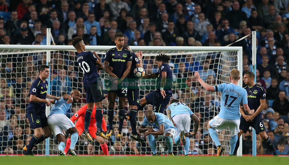 Manchester City's Kevin De Bruyne has a free kick blocked by the Everton defence
