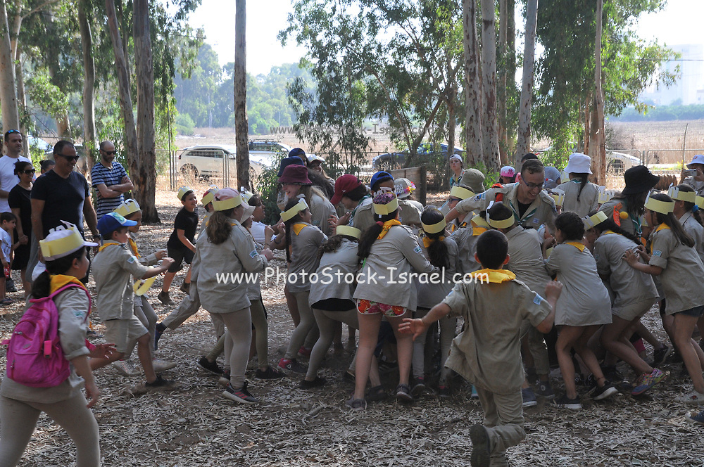 Children at the Israeli Scouts Youth Movement. <br /> The Israeli Scouts were founded in 1919 The Israeli Scouts are divided into troops, which include about 40,000 members across religions and sexes. Unlike other countries boys and girls are in the same groups