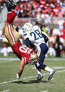 San Francisco 49ers inside linebacker Chris Borland (50) is upended as he leaps over the offensive line while trying to tackle San Diego Chargers running back Marion Grice (28) during the 2014 NFL preseason football game against the San Diego Chargers on Sunday, Aug. 24, 2014 in Santa Clara, Calif. The 49ers won the game 21-7. ©Paul Anthony Spinelli