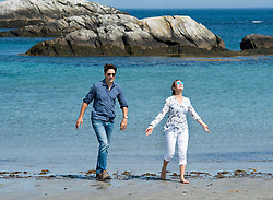Prime Minister Justin Trudeau and his wife Sophie Gregoire Trudeau walk on the beach at Kejimkujik Seaside National and Historic Park in Port Joli, N.S., Canada, on Friday, July 21, 2017. Photo by Andrew Vaughan/CP/ABACAPRESS.COM