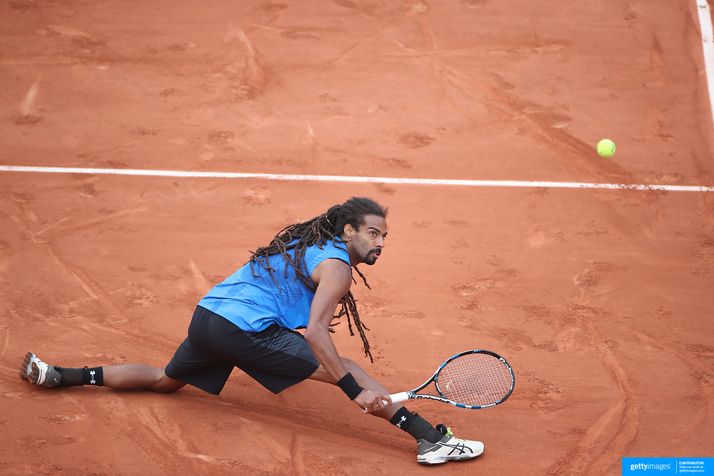2017 French Open Tennis Tournament - Day Three.  Dustin Brown of Germany in action against Gael Monfils of France on Suzanne-Lenglen Court during the Men's Singles round one match at the 2017 French Open Tennis Tournament at Roland Garros on May 30th, 2017 in Paris, France.  (Photo by Tim Clayton/Corbis via Getty Images)
