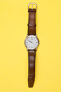 a wristwatch on a yellow background