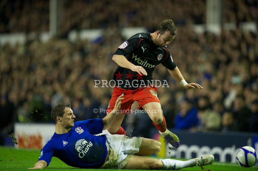 LIVERPOOL, ENGLAND - Tuesday, March 1, 2011: Everton's Phil Jagielka tackles Reading's Noel Hunt during the FA Cup 5th Round match at Goodison Park. (Photo by David Rawcliffe/Propaganda)