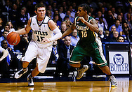INDIANAPOLIS, IN - FEBRUARY 13: Rotnei Clarke #15 of the Butler Bulldogs dribbles the ball against Denzel Ingram #10 of the Charlotte 49ers at Hinkle Fieldhouse on February 13, 2013 in Indianapolis, Indiana. Charlotte defeated Butler 71-67. (Photo by Michael Hickey/Getty Images) *** Local Caption *** Rotnei Clarke; Denzel Ingram