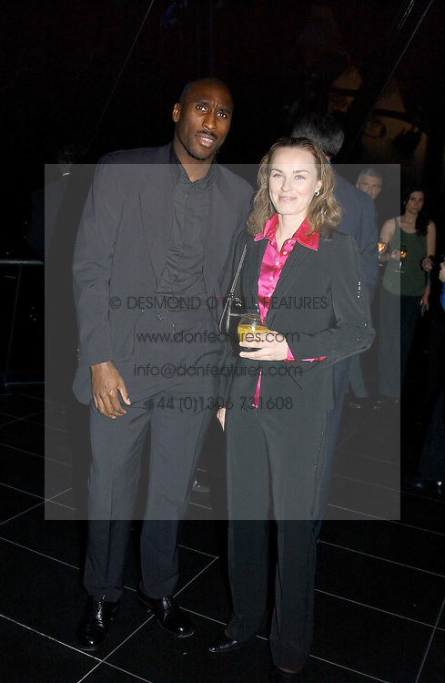 England international footballer SOL CAMPBELL and former tennis champion MARTINA HINGIS at a reception and buffet-dinner hosted by H.E.Alexis P.Lautenberg, Ambassador of Switzerland to celebrate British-Swiss friendship and the forthcoming 'UN International Year of Sport and Physical Education 2005' at 40 St.Mary Axe (The Gherkin) London EC3 on 13th December 2004.<br /><br />NON EXCLUSIVE - WORLD RIGHTS