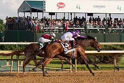 Nyquist with Mario Gutierrez up pushes past Gun Runner and went on to win the Kentucky Derby 142, Saturday, May 07, 2016 at Churchill Downs in Louisville.