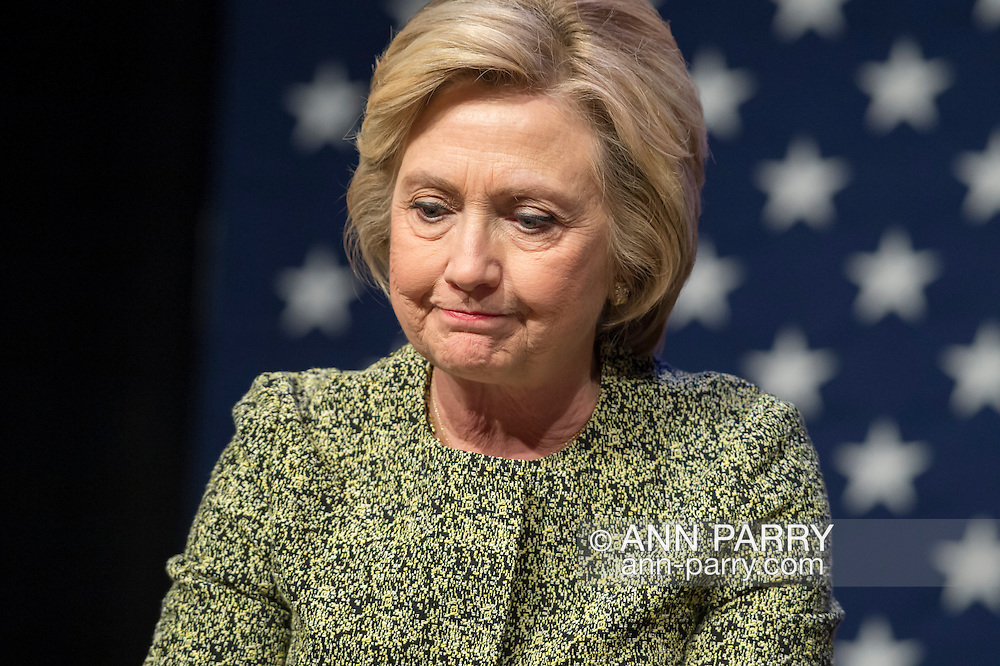 Port Washington, New York, USA. 11th April 2016. HILLARY CLINTON, leading Democratic presidential primary candidate, purses her lips during a discussion on gun violence prevention with Rep. S. Israel, and with activists who lost family members due to shootings. The activists shared their stories of personal loss, and Hillary Clinton, the former Secretary of State and U.S. Senator from New York, called for stronger gun legislation and vowed to take on the gun lobby NRA National Rifle Association. Clinton had several Long Island events scheduled this day, and New York presidential primary is April 19.