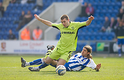 COLCHESTER, ENGLAND - Saturday, April 24, 2010: Tranmere Rovers' John Welsh is taken out by Colchester United's Steven Gillespie tackle during the Football League One match at the Western Community Stadium. (Photo by Gareth Davies/Propaganda)