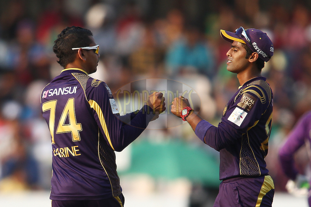 Sunil Narine of the Kolkata Knight Riders is congratulated by Suryakumar Yadav of the Kolkata Knight Riders for getting Travis Birt of the Hobart Hurricanes wicket during the first semi final match of the Oppo Champions League Twenty20 between the Kolkata Knight Riders and the Hobart Hurricanes held at the Rajiv Gandhi Cricket Stadium, Hyderabad, India on the 2nd October 2014<br /> <br /> Photo by:  Shaun Roy / Sportzpics/ CLT20<br /> <br /> <br /> Image use is subject to the terms and conditions as laid out by the BCCI/ CLT20.  The terms and conditions can be downloaded here:<br /> <br /> http://sportzpics.photoshelter.com/gallery/CLT20-Image-Terms-and-Conditions-2014/G0000IfNJn535VPU/C0000QhhKadWcjYs