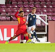 Scotland's Craig Slater and FYR Macedonia's Daniel Avramovski during Scotland Under-21 v FYR Macedonia,  UEFA Under 21 championship qualifier  at Tynecastle, Edinburgh. Photo: David Young<br /> <br />  - © David Young - www.davidyoungphoto.co.uk - email: davidyoungphoto@gmail.com