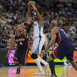 05 November 2008:  New Orleans Hornets forward James Posey (41) is defended by Atlanta Hawks guard Acie Law (4) and Maurice Evans (1) during a 87-79 victory by the Atlanta Hawks over the New Orleans Hornets at the New Orleans Arena in New Orleans, LA..