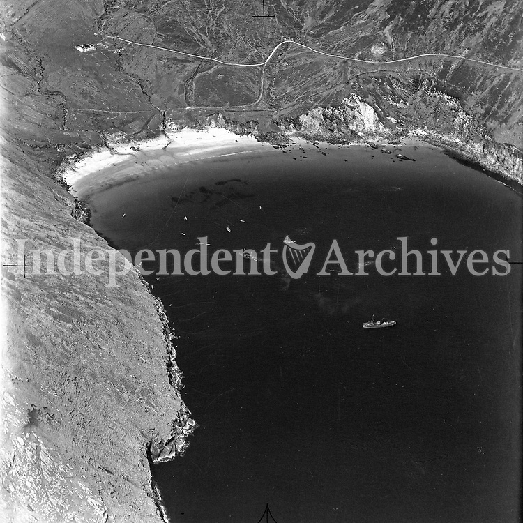 A226 Keem Bay.   01/10/54. (Part of the Independent Newspapers Ireland/NLI collection.)<br /> <br /> <br /> These aerial views of Ireland from the Morgan Collection were taken during the mid-1950's, comprising medium and low altitude black-and-white birds-eye views of places and events, many of which were commissioned by clients. From 1951 to 1958 a different aerial picture was published each Friday in the Irish Independent in a series called, 'Views from the Air'.<br /> The photographer was Alexander 'Monkey' Campbell Morgan (1919-1958). Born in London and part of the Royal Artillery Air Corps, on leaving the army he started Aerophotos in Ireland. He was killed when, on business, his plane crashed flying from Shannon.