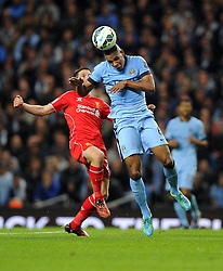 Manchester City's Fernando battles for the ball with Liverpool's Joe Allen - Photo mandatory by-line: Joe Meredith/JMP - Mobile: 07966 386802 25/08/2014 - SPORT - FOOTBALL - Manchester - Etihad Stadium - Manchester City v Liverpool - Barclays Premier League
