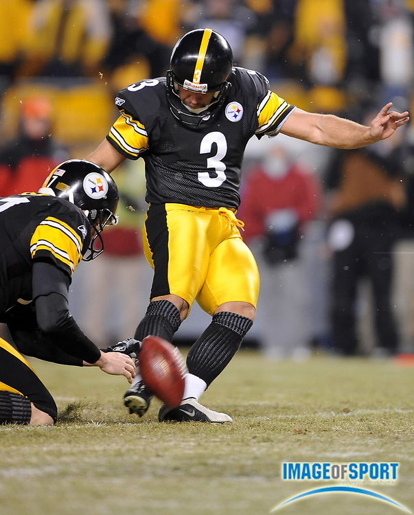 Jan 11, 2009; Pittsburgh, PA, USA; Pittsburgh Steelers kicker Jeff Reed (3) attempts an extra point out of the hold of Mitch Berger (17) during the Steelers' 35-24 victory over the San Diego Chargers in AFC Divisional playoff game at Heinz Field.