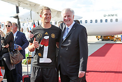 15.07.2014, Flughafen, München, GER, FIFA WM, Empfang der Weltmeister in Deutschland, Finale, im Bild l-r: Manuel Neuer #1 (Deutschland) und Horst Seehofer (Ministerpraesident) // during Celebration of Team Germany for Champion of the FIFA Worldcup Brazil 2014 at the Flughafen in München, Germany on 2014/07/15. EXPA Pictures © 2014, PhotoCredit: EXPA/ Eibner-Pressefoto/ Christian Kolbert<br /> <br /> *****ATTENTION - OUT of GER*****