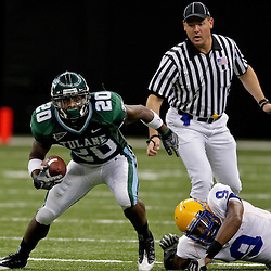 Sep 26, 2009; New Orleans, LA, USA; Tulane Green Wave wide receiver Jeremy Williams (20) runs away from McNesse State Cowboys safety Darrell Jenkins (9) at the Louisiana Superdome. Tulane defeated McNeese State 42-32. Mandatory Credit: Derick E. Hingle-US PRESSWIRE
