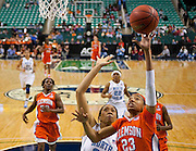 Clemson's Chancie Dunn (23) scores on this layup over North Carolina's Chay Shegog (20) during UNC's 78 - 64 opening round victory in the 2011 ACC Women's Basketball Tournament held at the Greensboro Coliseum in Greensboro, North Carolina.  (Photo by Mark W. Sutton)