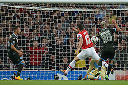 LONDON, ENGLAND - Oct 01: Napoli's midfielder Valon Behrami from Switzerland fails to stop Arsenal's forward Olivier Giroud from France from scoring a goal during the UEFA Champions League match between Arsenal from England and Napoli from Italy played at The Emirates Stadium, on October 01, 2013 in London, England. (Photo by Mitchell Gunn/ESPA)