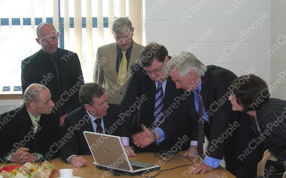 Gerry Reidy, Clare Fianna Fail County Secretary, takes An Taoiseach Brian Cowan TD on a tour of the Clare Fianna Fail Website, watched by Fianna Fail North West European Candidate Pascal Mooney, Sean Hillery Shannon, Noel McNamara and Wojciech Wisniewski Shannon Town Council candidates, and Mary O?Dwyer Treasurer Clare Fianna Fail.